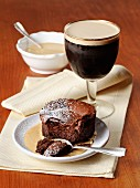 Chocolate cake with vanilla sauce and Irish coffee