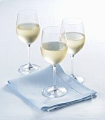 Glasses of white wine with condensation