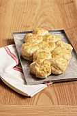 Fresh scones on a baking tray