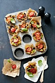 Pasta nests with tomatoes in a muffin tin