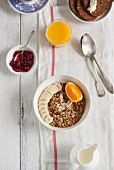 Granola muesli with banana and orange for breakfast (seen from above)