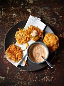 Vegetable cakes made from parsnip and pumpkin spirals with a dip
