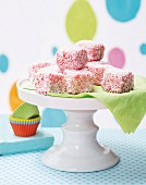 Strawberry bites covered with grated coconut