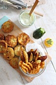Battered courgette slices, potato wedges and lattice potatoes with a dip
