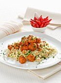 Couscous with meatballs in tomato sauce