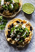 Tortialla with scrambled eggs, avocado, black beans and sunflower seeds