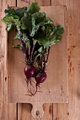 Beetroot with leaves on a wooden chopping board