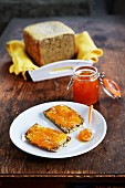 Two slices of wholemeal bread with apricot jam