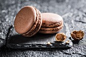 Hazelnut macaroons on a black stone