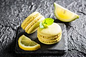 Lemon macaroons on a black stone