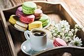 Coffee with colorful macaroons