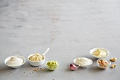 Various dips (garlic, nut and avocado) with mustard seeds