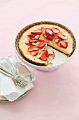White chocolate tart with strawberries and almonds