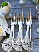 Silver cutlery with name tags on Easter buffet table