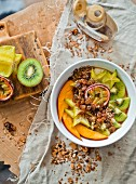 Oat muesli with fresh fruit, raisins and seeds
