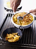 Älplermagronen (a dish from the Swiss Alps made from pasta, potatoes, cheese, cream and onions) with apple