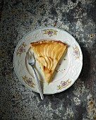A slice of apple tart with apple jelly