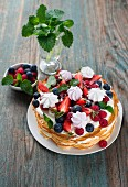 Waffle cake with berries and meringue
