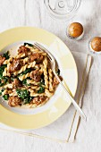 Spicy gemelli pasta with sausage and spinach