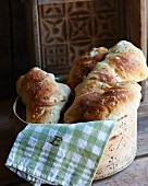 Three focaccia with caraway seeds in a bread basket