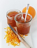 Two jars of orange marmalade with finely sliced ​​peel