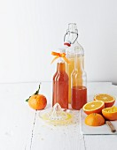 Homemade orange syrup in bottles
