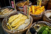 Root vegetables at the Nishiki market in Kyoto, Japan