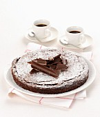 Dark chocolate cake and espressos