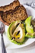Freshly sliced avocado with balsamic vinegar