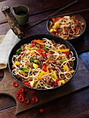 Fried egg noodles with pork, mango and chilies