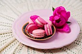 Pink macaroons decorated with spring flowers