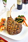 Grilled tomahawk steak with sides