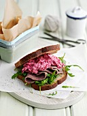 A beef sandwich with beetroot coleslaw