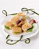 Mini cheese, pear, walnut and salad sandwiches