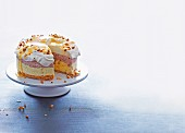 A bi-coloured ice cream cake with a biscuit base, egg liqueur and roasted hazelnuts