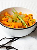 Carrot salad with grapes and garlic chives