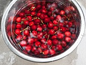Cherries in a large bowl of water