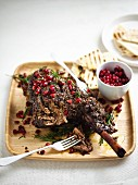 Slow-roasted leg of lamb with pomegranates and rosemary for Easter