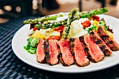 Grilled beef steak with asparagus salad
