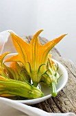 Courgette flowers in a ceramic bowl