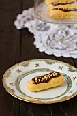 Chocolate eclairs with chopped nuts