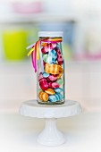 Colourful sweets in a small glass bottle