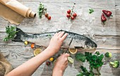 Raw salmon being prepared for cooking