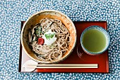 Soba noodles and green tea on an oriental serving platter (Japan)