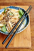 Soba noodle salad with tofu, courgettes and black sesame seeds (Japan)