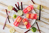 Homemade beetroot and lime ice lollies (seen from above)