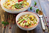 Vegan bulgur salad with vegetables, avocado and pomegranate seeds