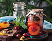 Preserved peaches in a jar