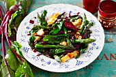Asparagus with beetroot and smoked cheese