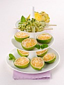 Lime cream served in lime skins with pineapple skewers